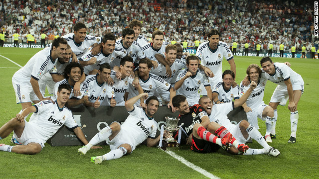Real Madrid players celebrate their Supercup win over rivals Barcelona