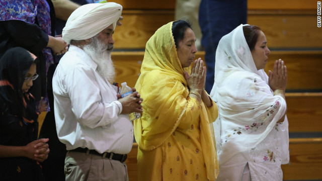 People gather to mourn the deaths of six members of the Sikh Temple of Wisconsin. A Sikh will lead a prayer at the RNC.