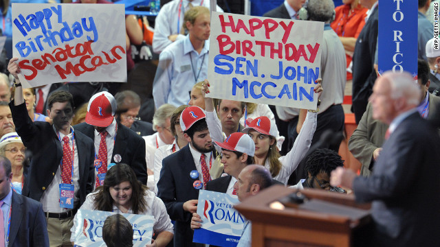 Arizona Senator John McCain speaks to the audience, some of them displaying Happy Birthday posters, during the 2012 Republican National Convention.