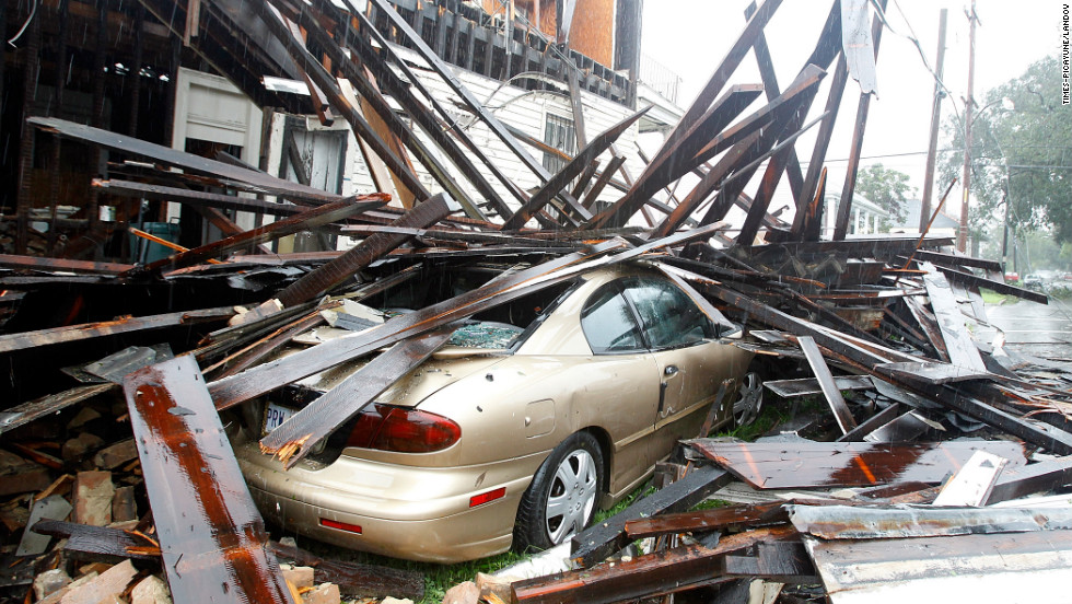 A house in New Orleans collapsed during the height of Hurricane Isaac, destroying three vehicles parked alongside it Wednesday.