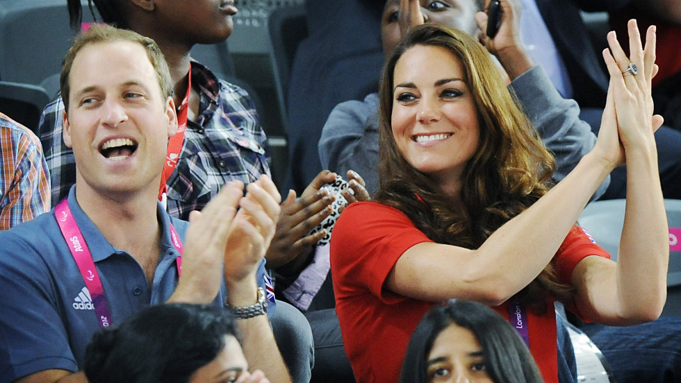 Prince William and his wife, Catherine, applaud as they watch British cyclist Sarah Storey break a world record in her C5 individual pursuit heat.