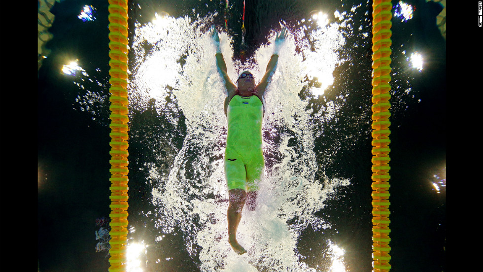 Natalie du Toit of South Africa competes in the women's 100-meter butterfly heat.