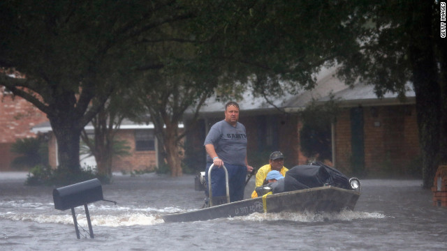 LAPLACE, LA - AUGUST 29:  Rescue workers transport residents trapped by rising water from Hurricane Isaac in the River Forest subdivision on August 29, 2012 in LaPlace, Louisiana. The large Level 1 hurricane slowly moved across southeast Louisiana, dumping huge amounts of rain and knocking out power to Louisianans in scattered parts of the state. (Photo by Chris Graythen/Getty Images)