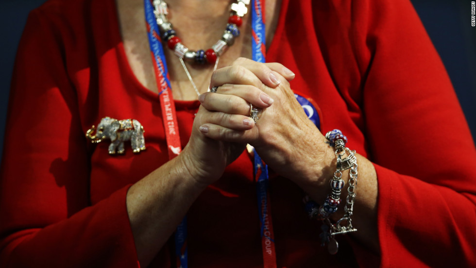 A woman grasps her hands during speeches on the third day of the GOP convention.