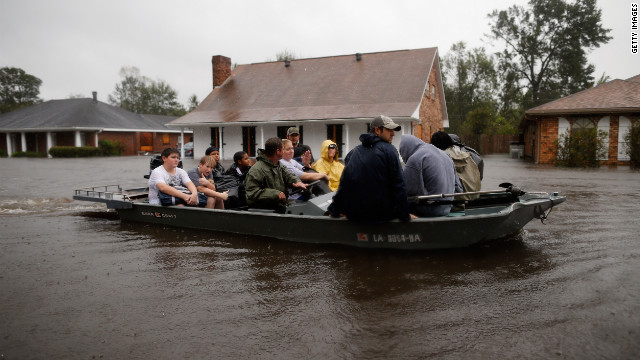 Rescue workers transport residents trapped by rising water from Tropical Storm Isaac in LaPlace, Louisiana, on Wednesday. The storm was later downgraded to a Tropical Depression.