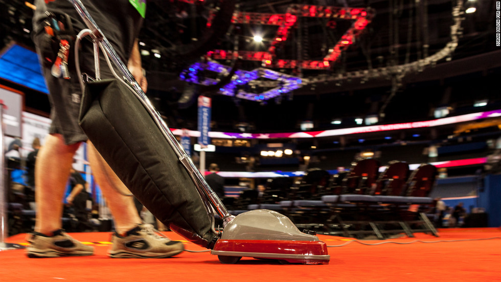 A worker cleans the convention hall on Thursday, the morning after Paul Ryan's speech.