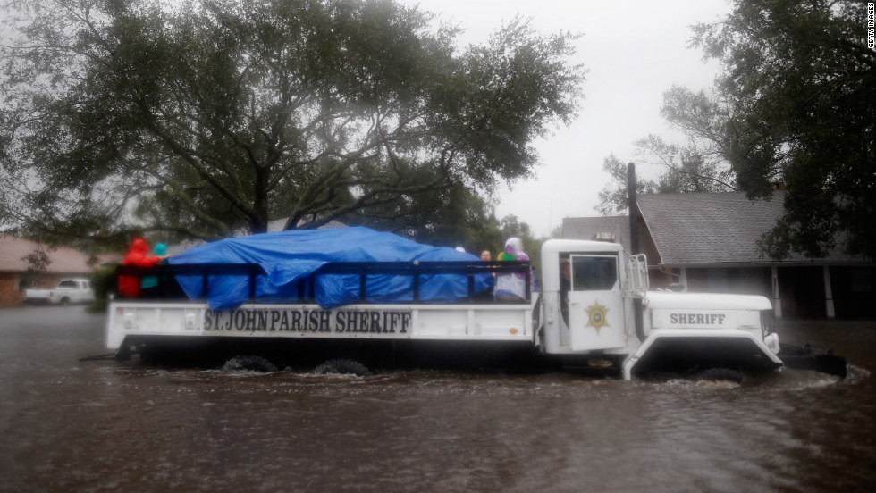 St. John Parish Sherriff officials rescue local residents from the flood waters in Laplace.
