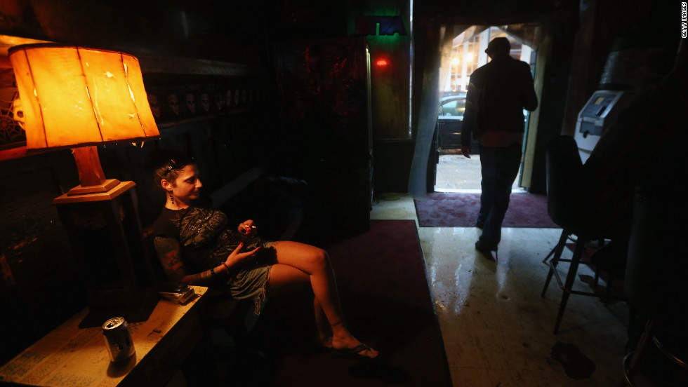 People gather at a bar in the French Quarter during ongoing rain from Isaac. The area appeared largely unscathed by the storm.