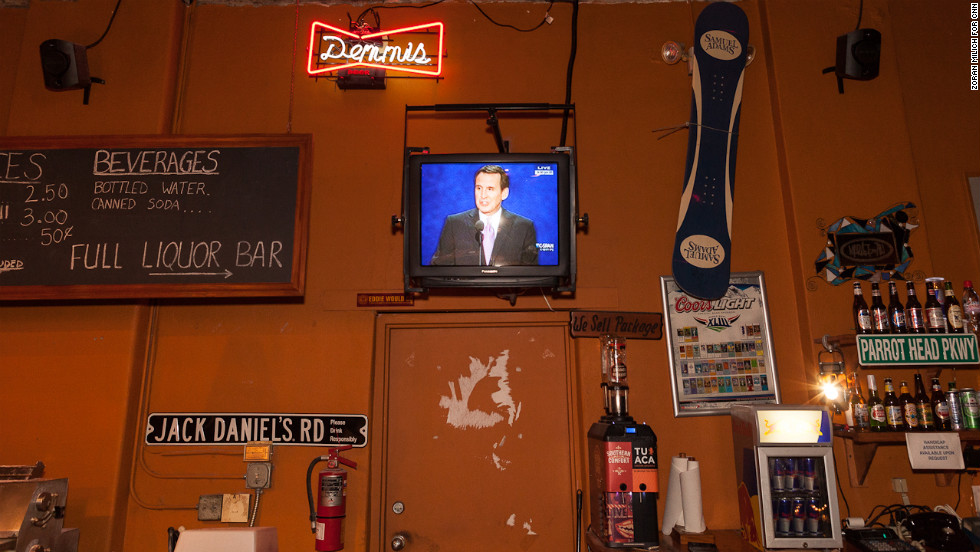 Former Minnesota Gov. Tim Pawlenty's speech at the convention is televised at a pizza bar in Tampa's Ybor City district on Wednesday, August 29.