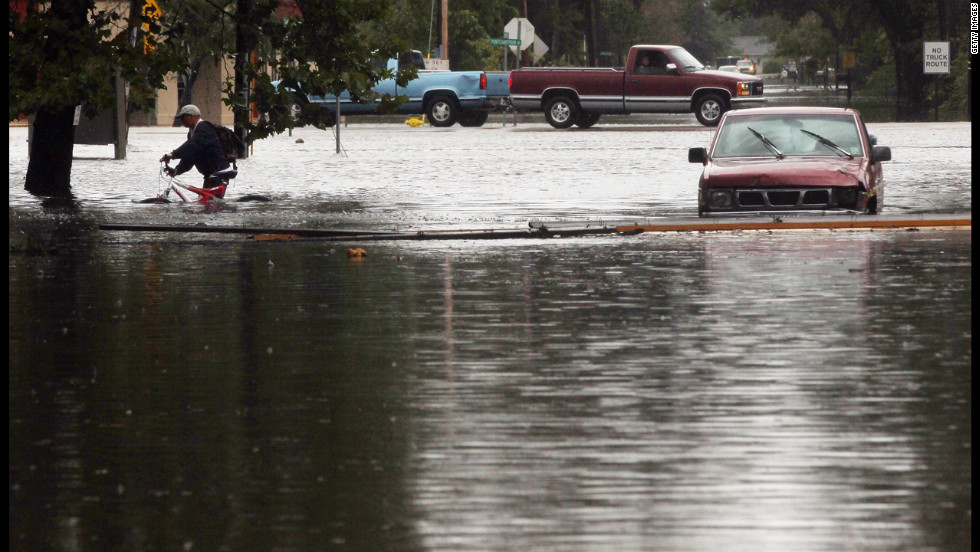 A resident evacuates an area flooded by Hurricane Isaac's storm surge on the north shore of Lake Pontchartrain.