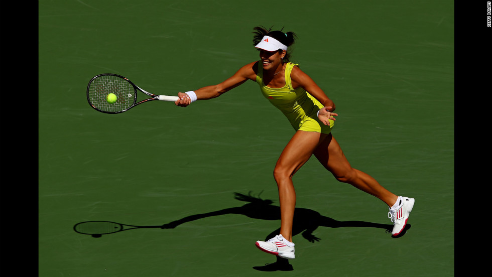 Ana Ivanovic of Serbia returns a shot against Sofia Arvidsson of Sweden during their women's singles second-round match.