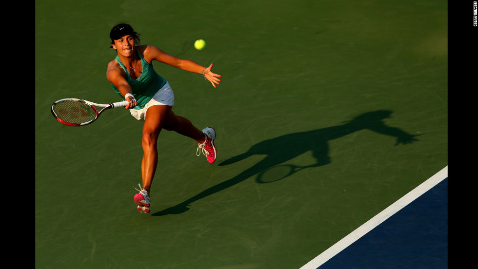 Tatjana Malek of Germany returns a shot during her women's singles second-round match against Sloane Stephens of the United States.
