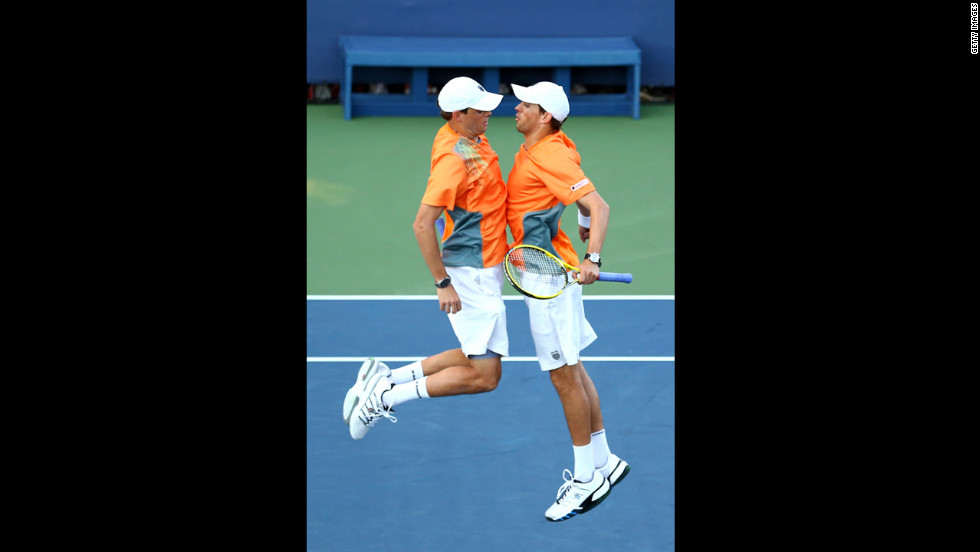 U.S. players Bob Bryan and Mike Bryan chest bump after winning match point in their men's doubles first-round match against Belgian players David Goffin and Steve Darcis.