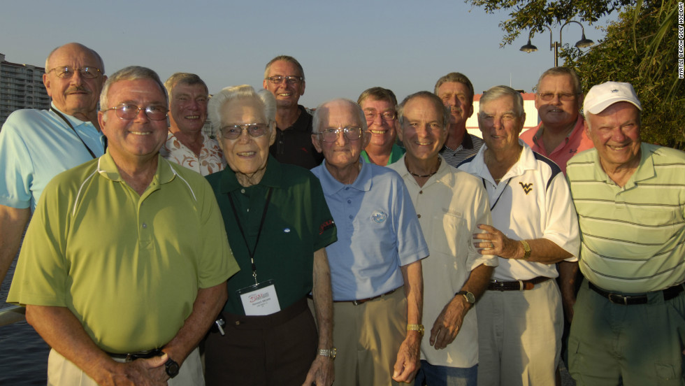 Yelton (front left) and the group of players who have competed in all previous editions of the tournament.