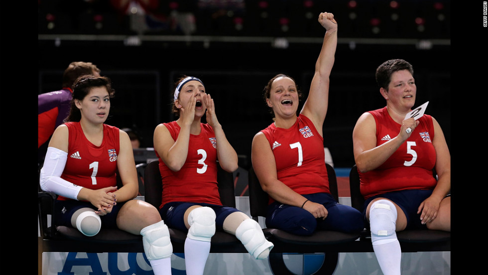 Julie Rogers, from left, Jessica Frezza, Martine Wright and Andrea Green of Great Britain react to a point during the opening game of the womens sitting volleyball tournament against Ukraine.