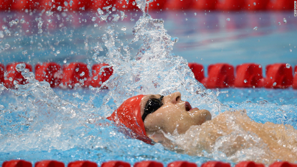 James Crisp of Great Britain swims in the men's 100-meter backstroke.