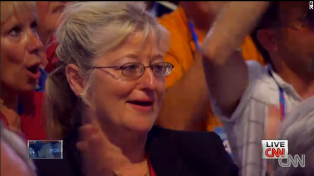 An unidentified woman tears up as Mitt Romney speaks about his parents during Thursday night's speech.