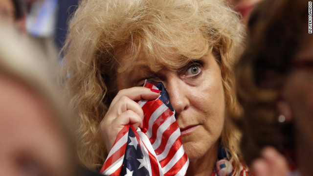 Cheryl Howell, a delegate from Michigan, wipes tears during the final session of the Republican National Convention.