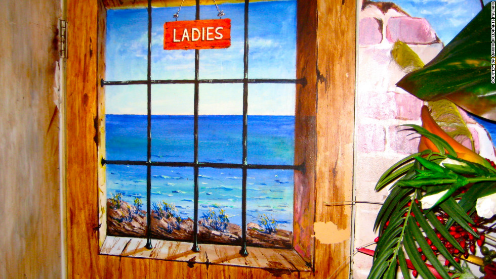 A hand-painted door welcomes ladies to the restroom at Da Marino, which evokes the Italian Renaissance within its narrow walls.