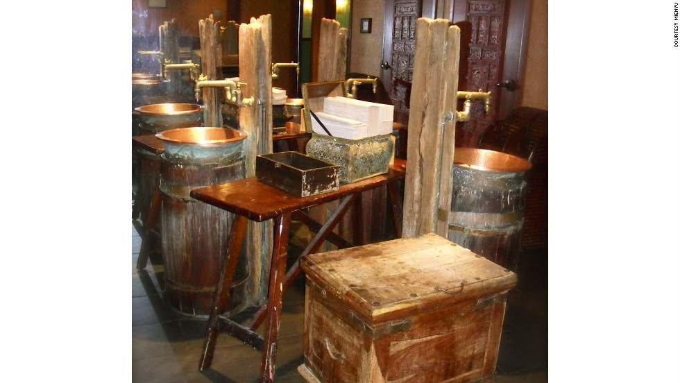 Wooden barrels house sinks in the unisex washroom at Mie N Yu in Georgetown. The rustic restroom is an extension of the restaurant's exotic blend of influences. In the dining room, themed spaces, from a Turkish tent to a Venetian lounge, cocoon diners.