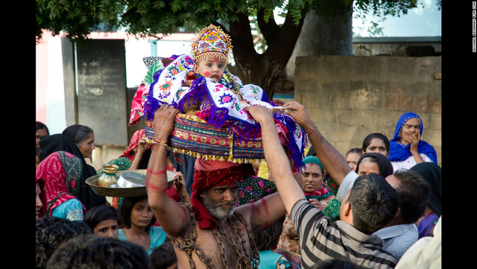 While the weddings were taking place, traditional Janmashtami celebrations were also held. Here, a child plays the role of baby Krishna being delivered to safety by his father, Vasudeva.