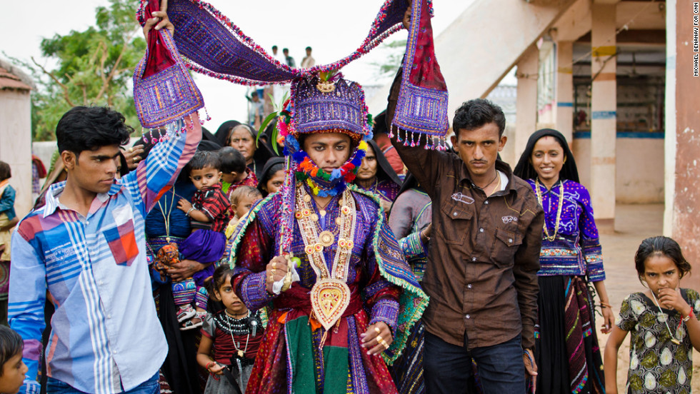 For many of the migratory Maldhari communities in the Kutch region of Gujarat, India, the Hindu holiday of Janmashtami, which celebrates the god Krishna's birthday, is the one day of the year when marriages are performed. Prabhubhai Kalar, center, a young groom, leads a procession to his bride's home, where the wedding will be held. He will meet his bride for the first time at their wedding, but won't see her face until later that night.