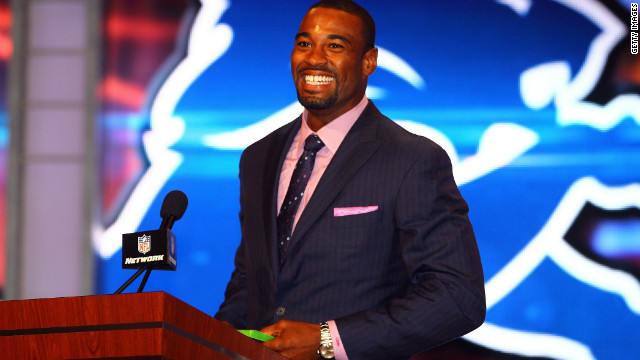 """Madden NFL '13"" cover player Calvin Johnson of the Detroit Lions announces a Lions' pick at the 2012 NFL Draft in New York."