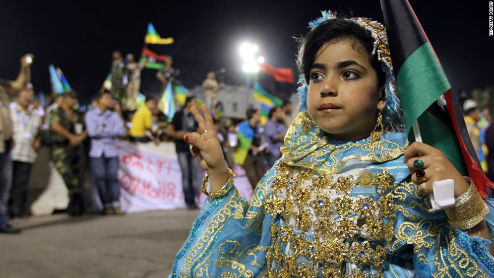 A Berber girl dressed in traditional attire at a Berber cultural festival in Tripoli. Public displays of Amazigh culture were forbidden under the Gadhafi regime.