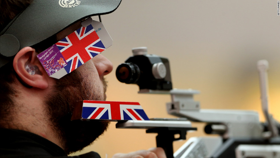 Great Britain's Ryan Cockbill lines up his shot at the shooting range during the P2-10-meter air pistol SH1 final.