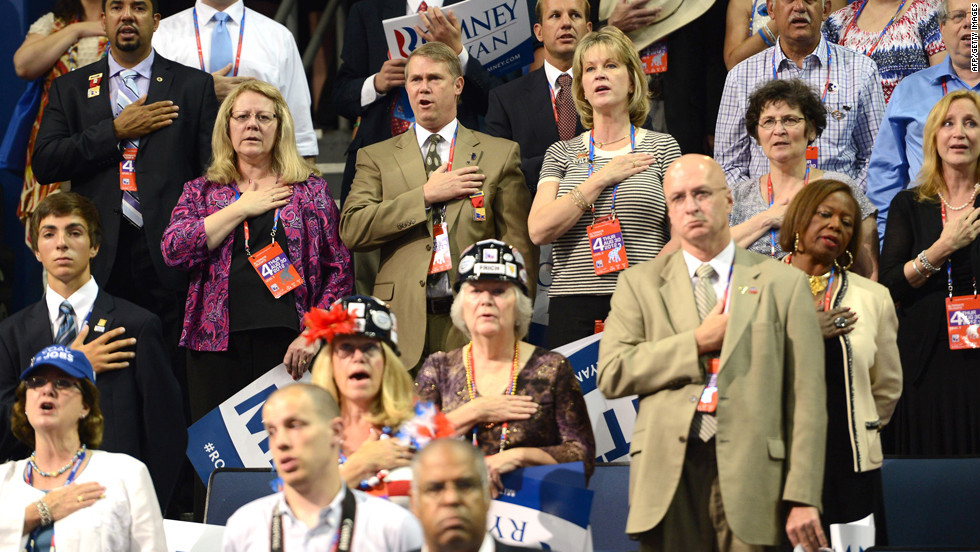 Delegates listen to the national anthem at the Tampa Bay Times Forum.