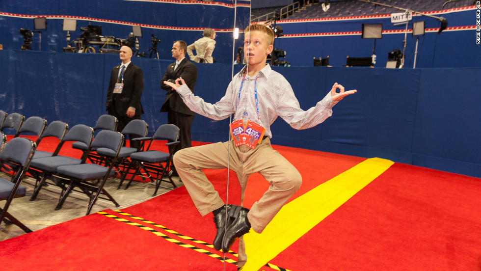Californian Kaden Tollestrup, great-nephew of Mitt Romney, strikes a pose for his family on the floor of the convention.