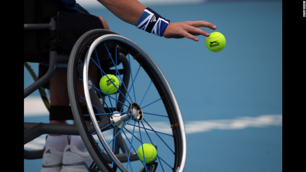 Gordon Reid of Great Britain prepares to serve during the men's singles wheelchair tennis round 64 match against Takuya Miki of Japan in London on Saturday, September 1.