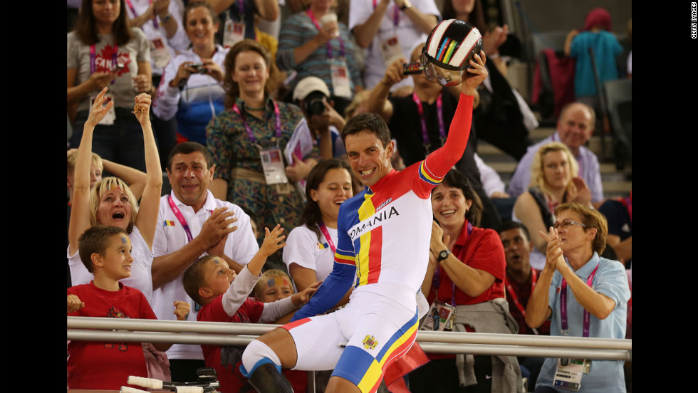 Carol-Eduard Novak of Romania celebrates winning gold in the men's individual C4 pursuit final.