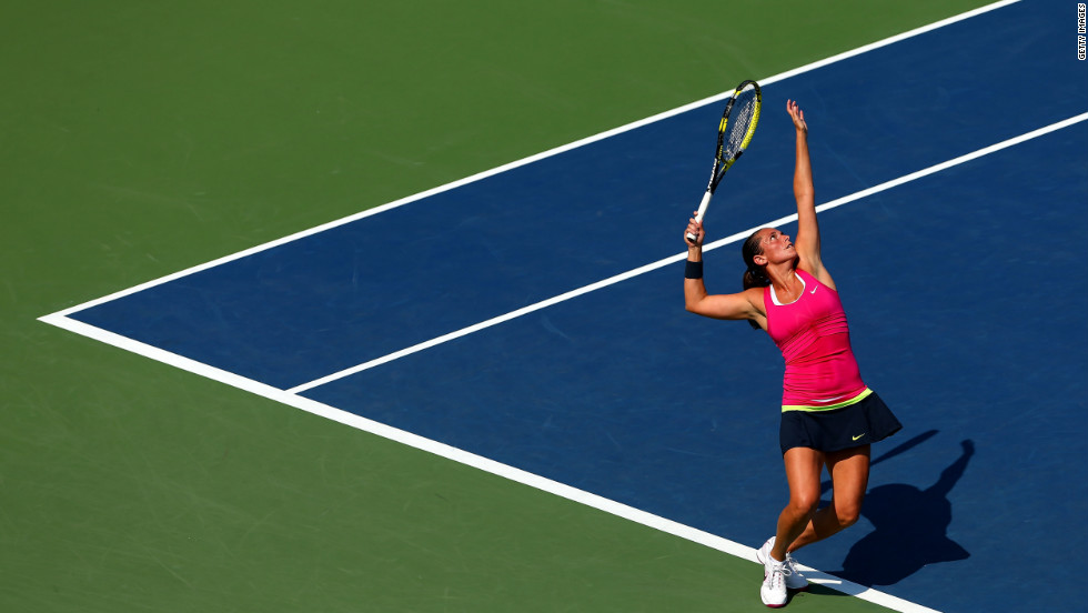 Roberta Vinci of Italy serves against Dominika Cibulkova of Slovakia during a women's singles third-round match.