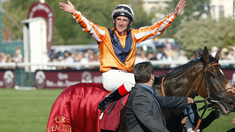 Andrasch Starke celebrates on Danedream after winning the 2011 Prix De L´Arc De Triomphe at Longchamps.