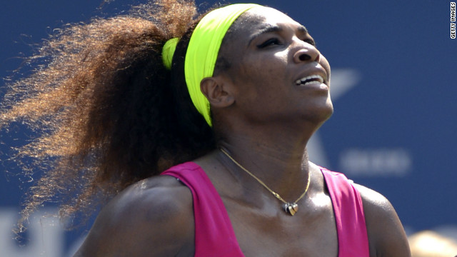 Serena Williams rushes to the net after her straight sets win over Ekaterina Makarova at the U.S. Open.