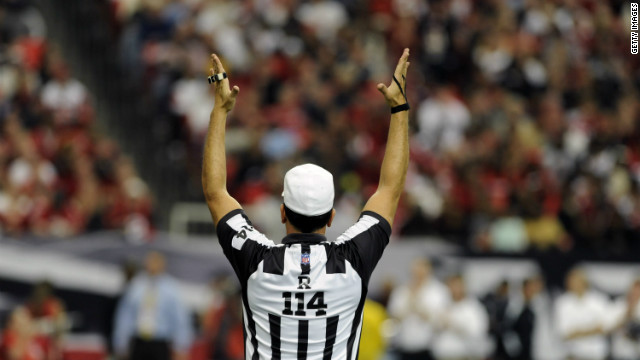 ATLANTA - NOVEMBER 9: NFL referee Gene Steratore signals a score as the New Orleans Saints host the Atlanta Falcons at the Georgia Dome on November 9, 2008 in Atlanta, Georgia. (Photo by Al Messerschmidt/Getty Images)