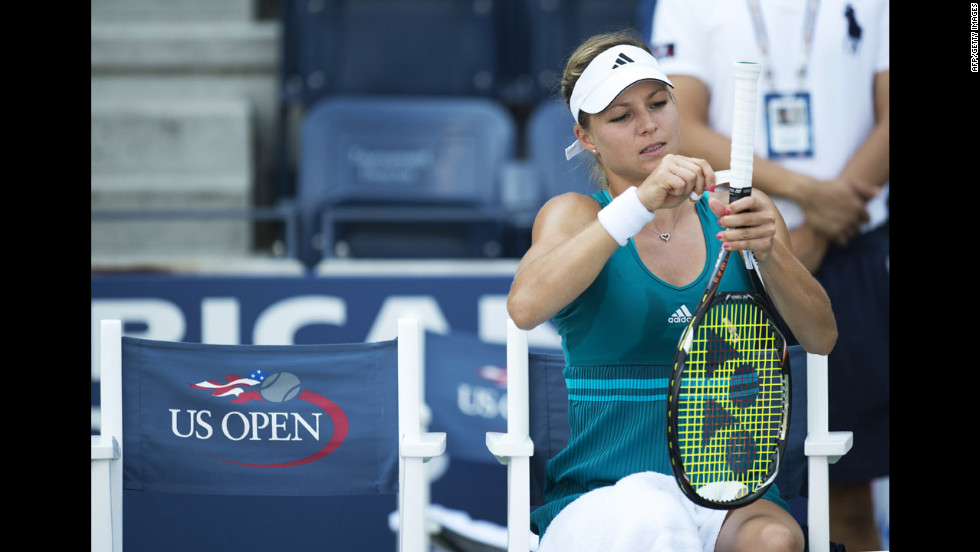 Maria Kirilenko of Russia tapes her racquet handle during a break in her match against Czech Andrea Hlavackova.