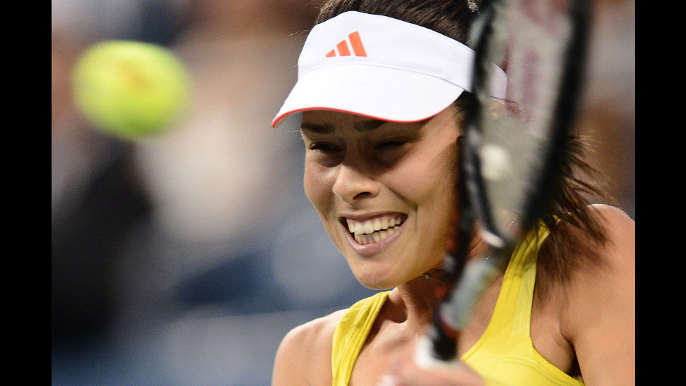 Ana Ivanovic of Serbia plays a shot against American Sloane Stephens.