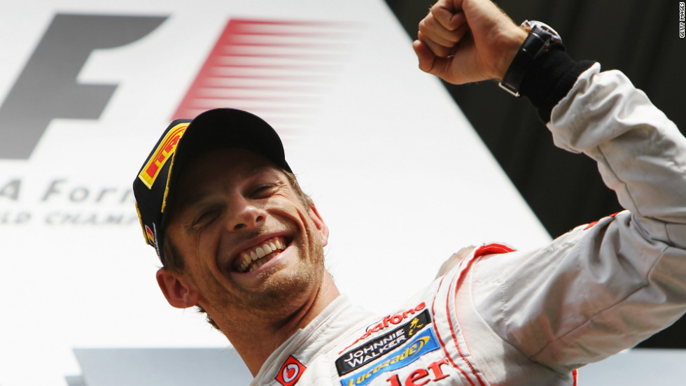 A delighted Jenson Button was left to celebrate his 14th F1 career victory after a superb performance in the Belgian GP.