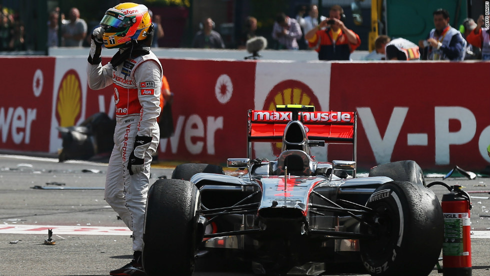 A disgruntled Hamilton gestures in the direction of Grosjean after being taken out in the first corner incident at Spa-Francorchamps.