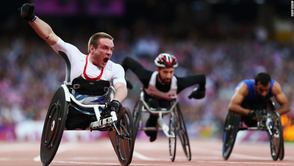 Mickey Bushell of Great Britain crosses the line to win gold in the men's 100-meter final.
