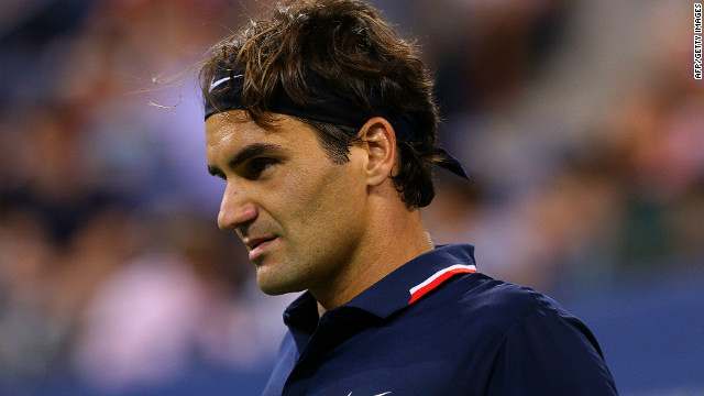 Roger Federer is through to the quarterfinals of the U.S. Open after his last 16 opponent, Mardy Fish withdrew