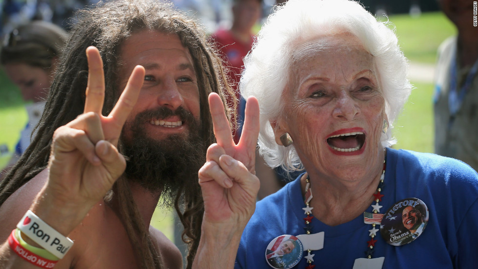 Charlotte Gardner, 86, poses for a picture with Aneheim James, a protester from California, after she marched with the Democratic Women of Mecklenburg County in the Charlotte Labor Day Parade on Monday.