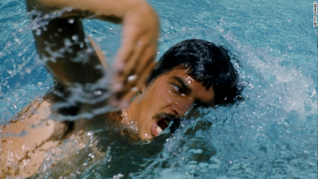 Mark Spitz competes in the 1972 Munich Olympics, where he won seven gold medals.
