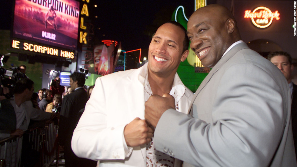 "Duncan and his friend and co-star The Rock attend the Los Angeles premiere of ""The Scorpion King"" in 2002."