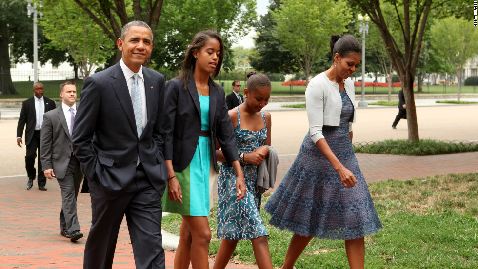 The first family walks across Lafayette Park to attend Sunday services in Washington in August 2012.