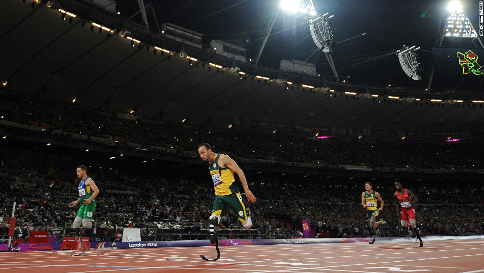 Brazil's Alan Fonteles Cardoso Oliveira, left, crosses the line ahead of South Africa's Oscar Pistorius to win the men's 200-meter T44 final on Sunday, September 2.