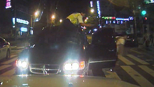 S.korea cop on car