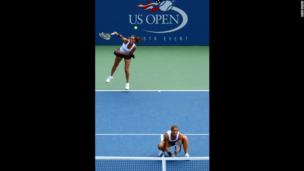 Roberta Vinci serves as she and Italian teammate Sara Errani play a women's doubles quarterfinals match on Tuesday.
